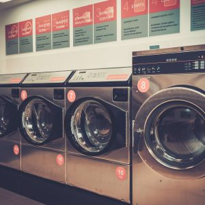 Laundry machines at laundromat shop.