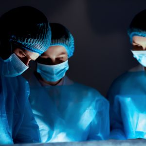 Team of professional surgeons performing surgery in hospital