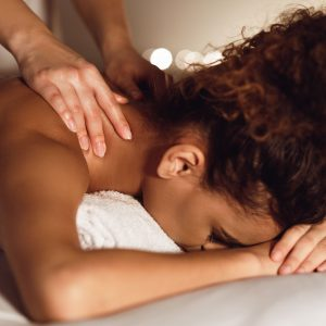 Woman enjoying therapeutic neck massage in spa
