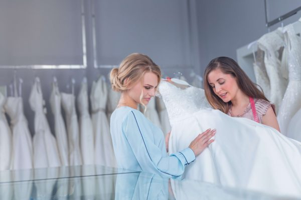 Young women with a wedding dress